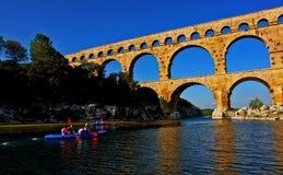 Canoeists de Pont du Gard Fotografía de archivo