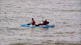 Canoeists fishing in canoe kayak. Video footage of canoeists fishing out to sea in their canoe kayak vessel stock video