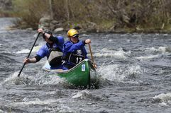 Two Men Paddling A Canoe In The Hudson River White Water Derby. Canoeists, Hudson River White Water Derby, Adirondack Forest Preserve, New York stock photography