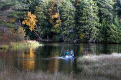 Canoeists on lake Royalty Free Stock Image