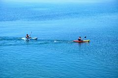 Canoeists at Lyme Regis. Stock Images