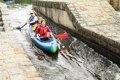 Canoeists on river village Rozmberk Stock Photography