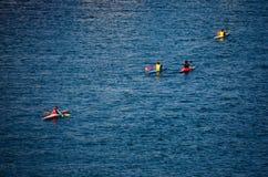 Canoeists in sea Stock Photos