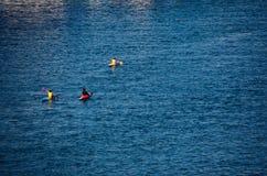 Canoeists in the sea savona Royalty Free Stock Photo