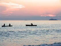 Canoeists at Sunset. Canoeists paddling at sunset. Lake Superior Provincial Park, Ontario Royalty Free Stock Photos