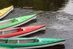 Canoes. Four canoes in the water Royalty Free Stock Image