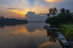 Free Canoes At Sunset In The Amazon River Basin, Ecuador Royalty Free Stock Photography - 142014707