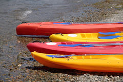 Canoes at the beach. Four canoes lying on the beach royalty free stock image