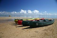 Canoes on Beach. Coloured Canoes on Beach Stock Photos