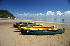 Canoes on Beach. Colourful canoes on sandy beach with water in background, Fraser Island, Queensland, Australia stock images