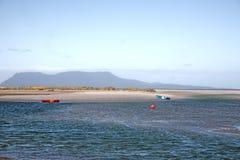 Canoes at beach, Tasmania Royalty Free Stock Images
