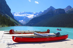 Canoes on beautiful turquoise Lake Louise royalty free stock photo