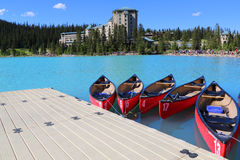 Canoes on beautiful turquoise Lake Louise stock photo