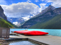 Canoes on Beutiful Lake Louise Royalty Free Stock Photos