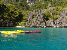 Canoes on blue lagoon Stock Image