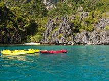 Canoes on blue lagoon Stock Image