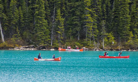 Canoes on Blue Water of Lake Louise royalty free stock photography
