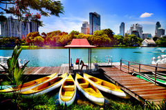 Canoes and boats in Lumpini Park in Bangkok, Thailand Royalty Free Stock Photo