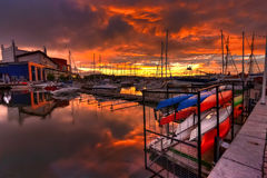 Canoes, boats and the sea Stock Image