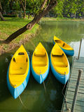 Canoes. The canoe boats and a wooden pier Stock Photography