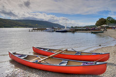 Canoes on Coniston water Royalty Free Stock Photo