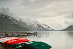 Canoes and dock Lake Crescent Royalty Free Stock Image