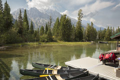Canoes, dock and mountains at Jenny Lake, Jackson Hole, Wyoming. Stock Photo