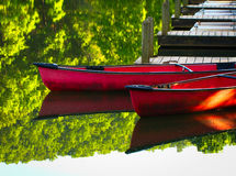 Canoes at dock 2 Royalty Free Stock Images