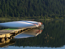 Canoes in early morning light stock image