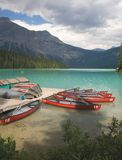Canoes on Emerald lake. Canoes ready for hire on Emerald lake in the Canadian Rocky Mountains stock photo