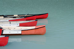 Canoes on Emerald Lake. Canoes on a glacier fed lake in Banff National Park, Alberta, Canada Stock Photography
