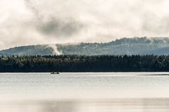 Canada Ontario Lake of two rivers Canoe Canoes on near the water in Algonquin National Park. Canoes floating peacefully on the waters of Lake Louise, Banff Stock Images