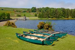 5 or 6 canoes. I took this photo at Cod Beck Reservoir. Only after I got home did I notice the optical illusion effect of the position of the canoes. How many stock photo