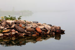 Canoes and kayak in fog. Canoes and kayaks in early morning light Royalty Free Stock Photo