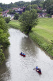 Canoes and kayaks floating down the Galena River in Galena Illinois Royalty Free Stock Photo