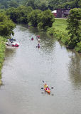 Canoes and kayaks floating down the Galena River in Galena Illinois Royalty Free Stock Images
