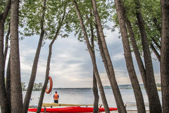 Canoes and kayaks on lake Royalty Free Stock Images