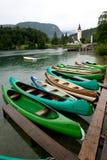 Canoes on the Lake Bohinj. Canoes facing the church dedicated to John the Baptist in Ribcev Laz on the Bohinj Lake, in Slovenia Stock Photography