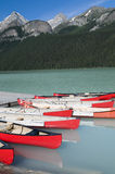Canoes at Lake Louise. Canoes on Lake Louise located in Banff National Park Royalty Free Stock Images