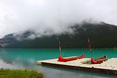 Canoes on Lake Near Mountain Royalty Free Stock Photos