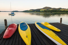 Canoes- Lake Obertumer, Austria. In a tranquil summer afternoon setting Royalty Free Stock Photo