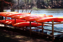 Canoes on the Lake's Edge. These canoes overlooking a peaceful lake are in Wisconsin Stock Image