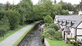 Canoes on Llangollen canal north Wales UK beautiful Welsh tourist destination stock video