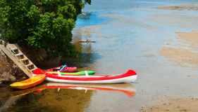Canoes at low tide Stock Photography