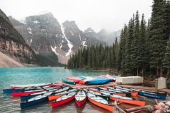 Canoes at Moraine Lake Alberta stock images