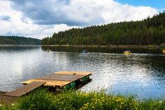 Canoes in a mountain lake. Stock Photography