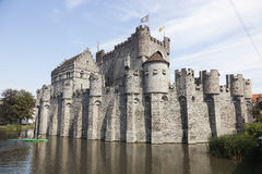 Canoes near castle gravensteen in belgium city of ghent Royalty Free Stock Images