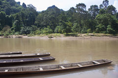 Canoes near Tham Kong Lo cave Royalty Free Stock Photography