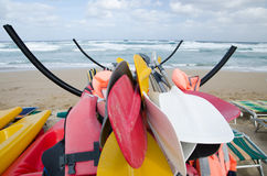 Canoes parked on a stormy sea. Rough sea. No canoes in water Stock Photo