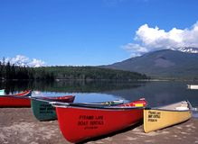 Canoes by Pyramid Lake, Canada. Royalty Free Stock Images